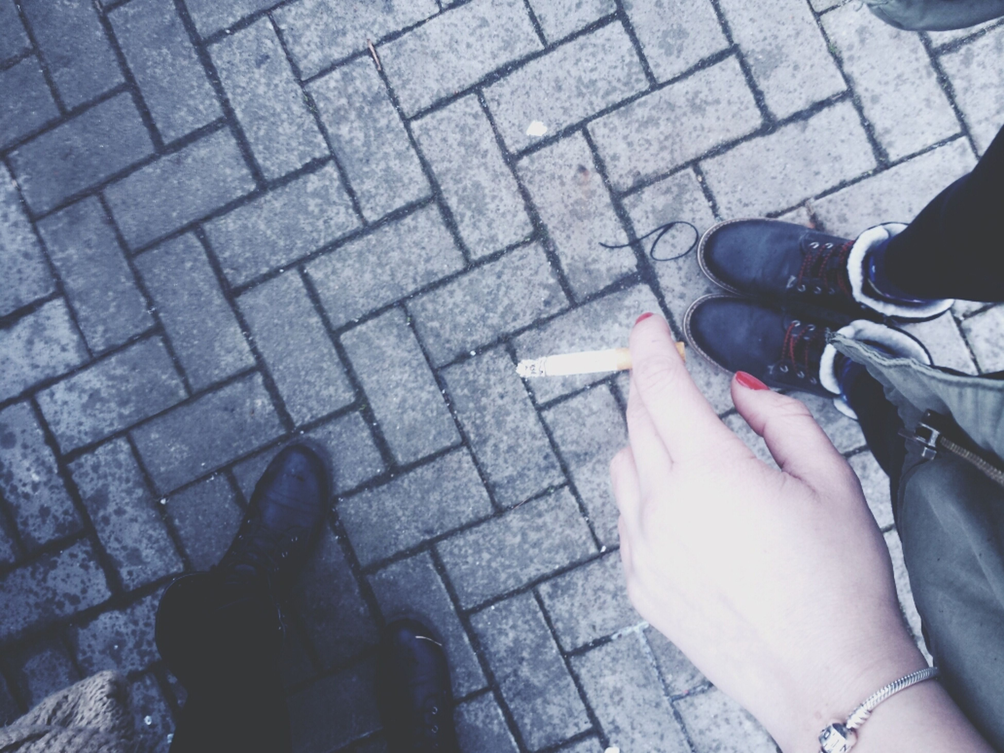 low section, person, lifestyles, personal perspective, leisure activity, high angle view, human foot, men, street, cobblestone, part of, standing, shoe, unrecognizable person