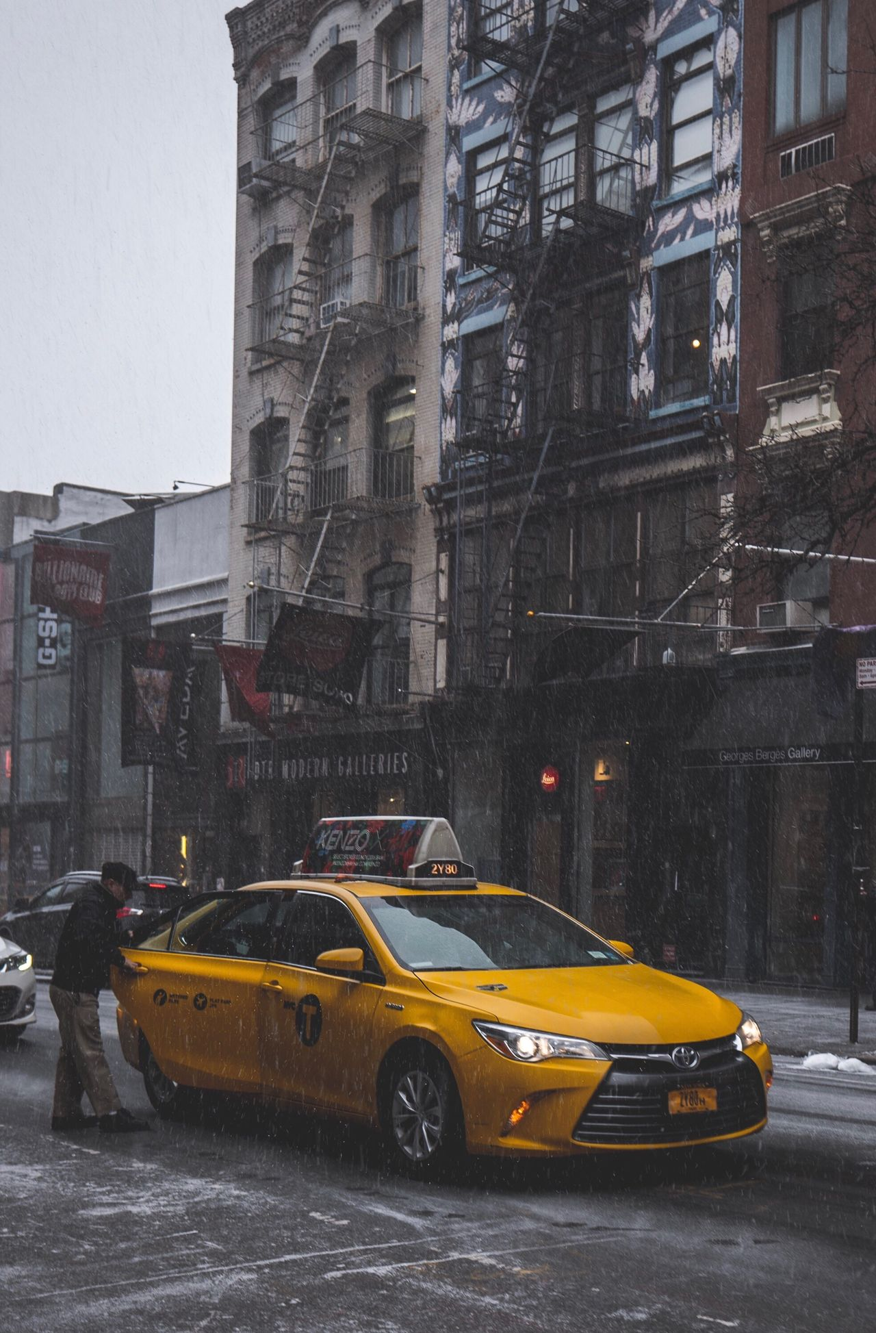 Building Exterior City Street Built Structure Architecture Taxi Yellow Transportation City Street Yellow Taxi Mode Of Transport Car Land Vehicle City Life Day Wet Outdoors Rainy Season No People