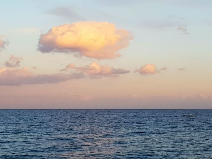 Sea Sunset Scenics Horizon Over Water No People Outdoors Beach Beauty In Nature Sky Day Sea Sunset Tranquility Sea View Relaxing View Serendipity Peace And Quiet Sunset At The Beach Clouds And Sea Sky Sunset Cloud Cloud Cloud - Sky Dramatic Sky Vacations Refraction Waves EyeEmNewHere