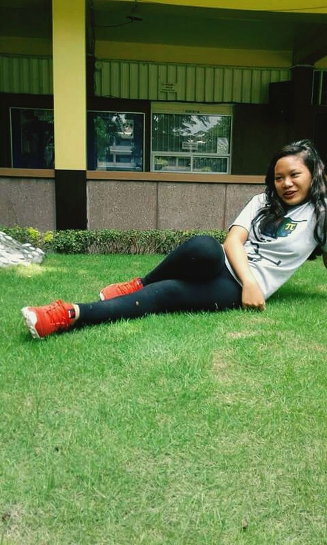 Grass Full Length Side View Casual Clothing Green Color Leisure Activity Architecture Young Adult Playing Strength Grassy Day Person Person Plant Philippines Natural Beauty Philippines Photos Green Color Smiling Enjoyment Lovely Happiness Adorable Field