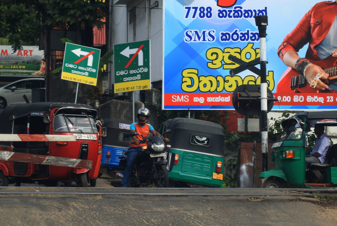 City City Life Day Grade Crossing Information Information Sign Kandy_town Land Vehicle Mode Of Transport Motorcycle Outdoors Road Road Sign Sri Lanka TukTuk