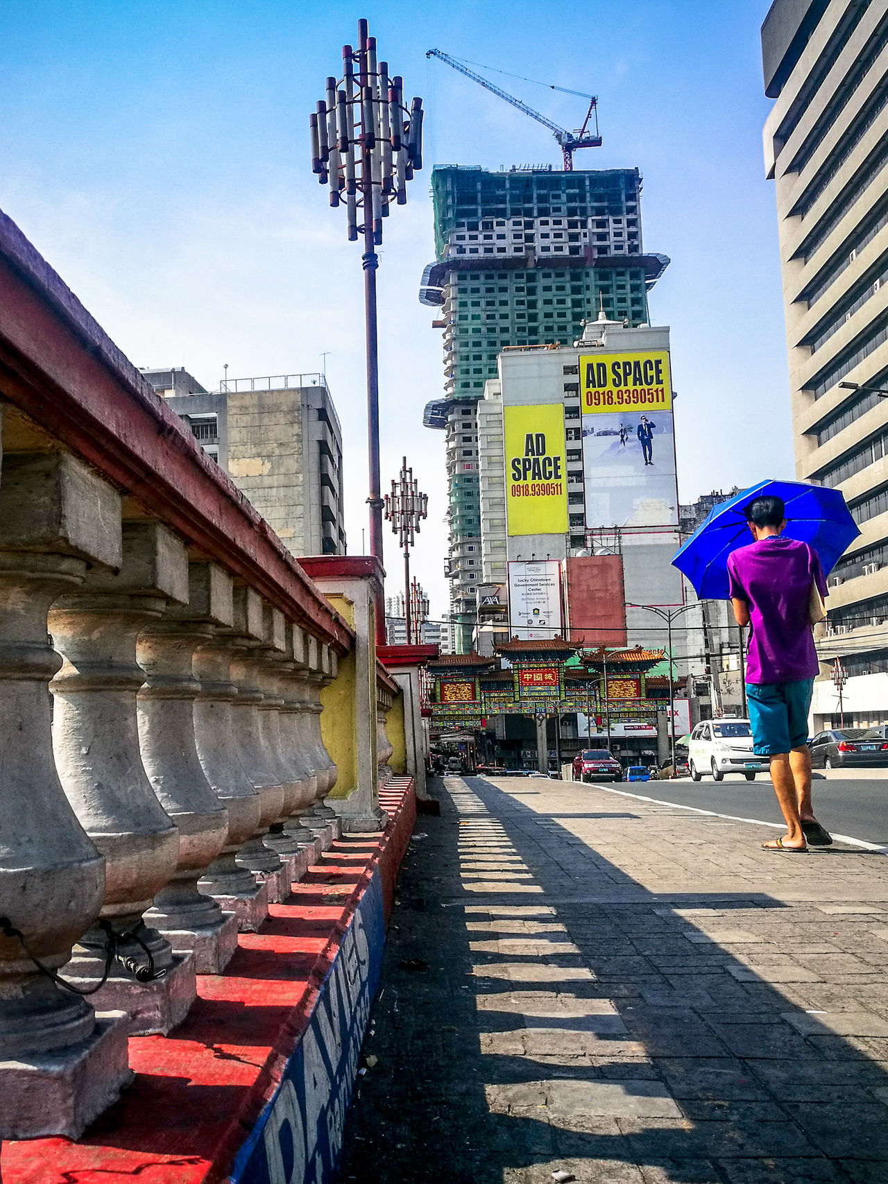 Road to Binondo... Adult Full Length Adults Only One Person Walking One Man Only Rear View City City Life Men Only Men Outdoors Street Road Umbrella Shadow Patterns Colums Street Photography Ads Space Ads The Street Photographer - 2017 EyeEm Awards