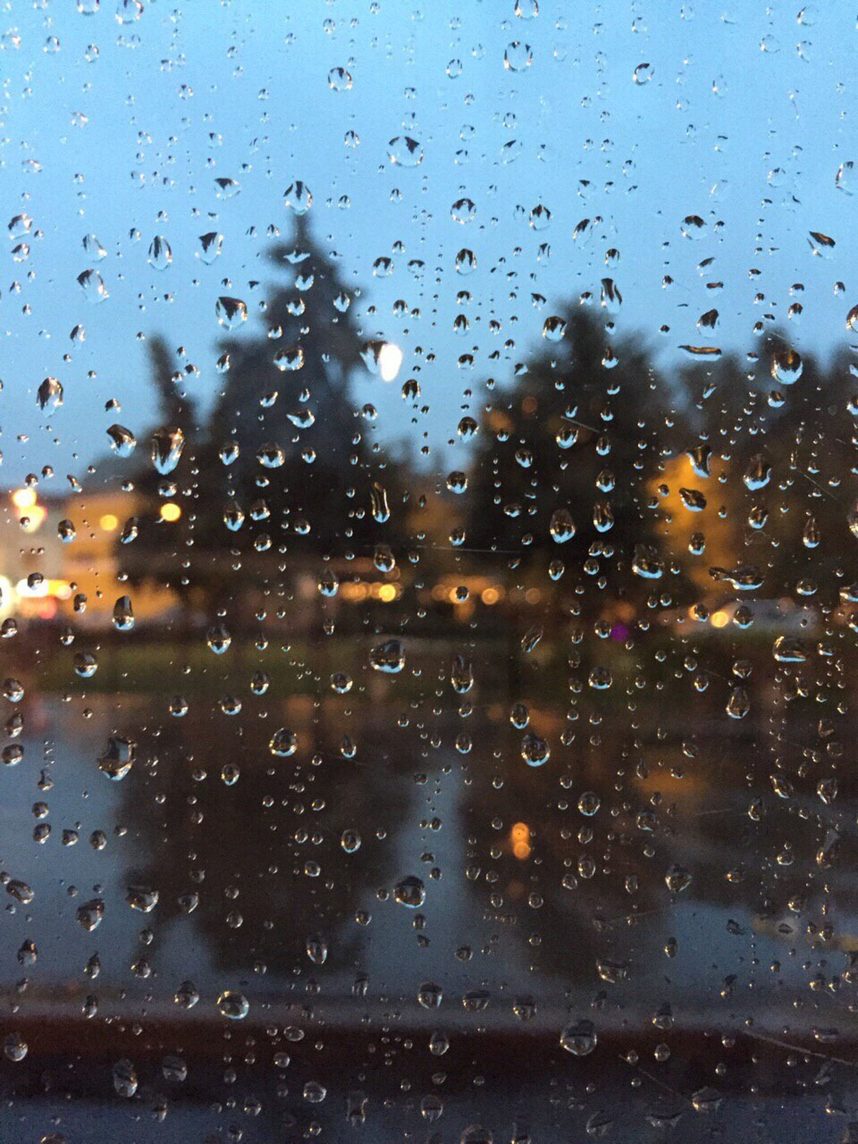glass - material, window, transparent, wet, drop, weather, rain, transportation, no people, car, sky, vehicle interior, indoors, close-up, water, rainy season, day, backgrounds, raindrop, nature