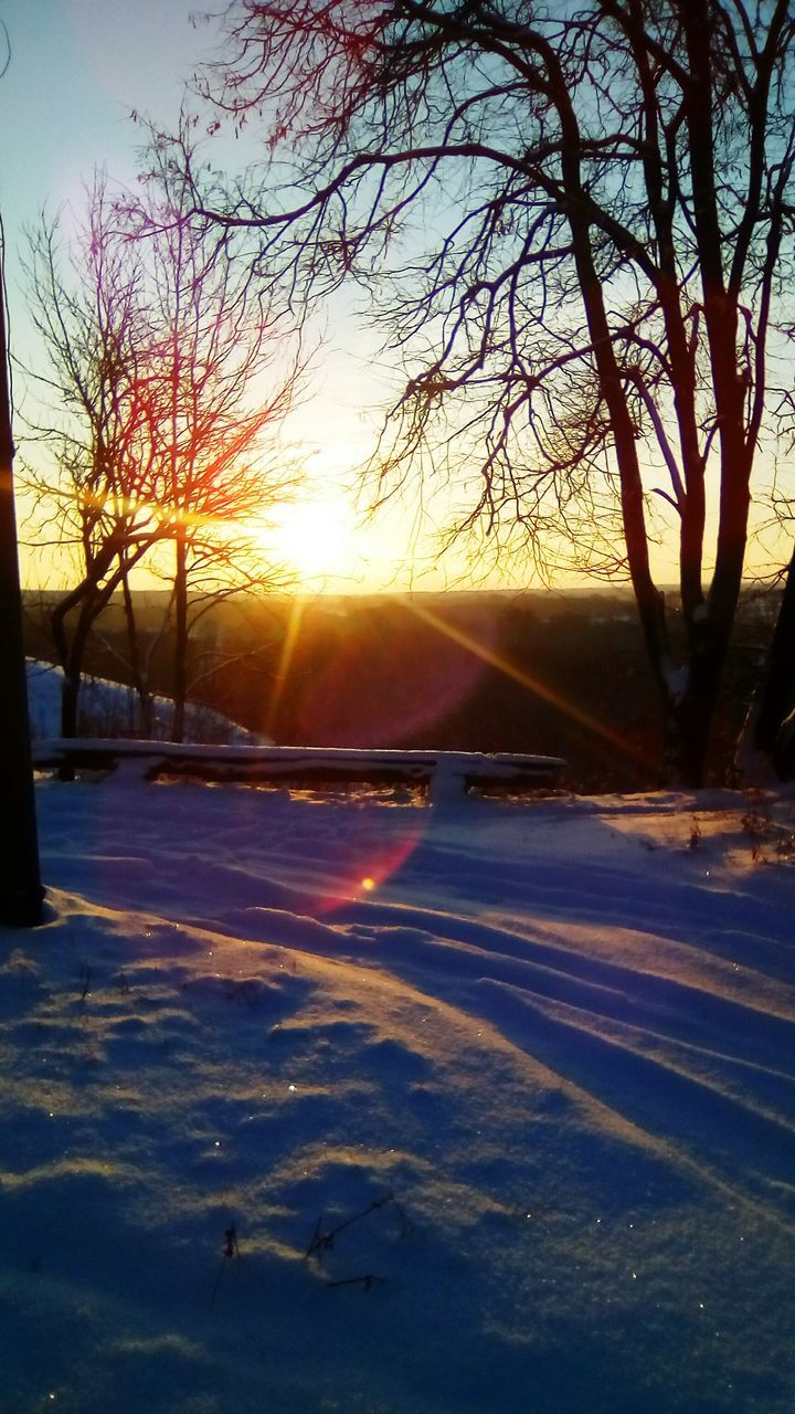 sunset, winter, cold temperature, snow, nature, scenics, beauty in nature, sun, tranquility, tranquil scene, sunlight, tree, frozen, cold, bare tree, sky, no people, outdoors, landscape, day