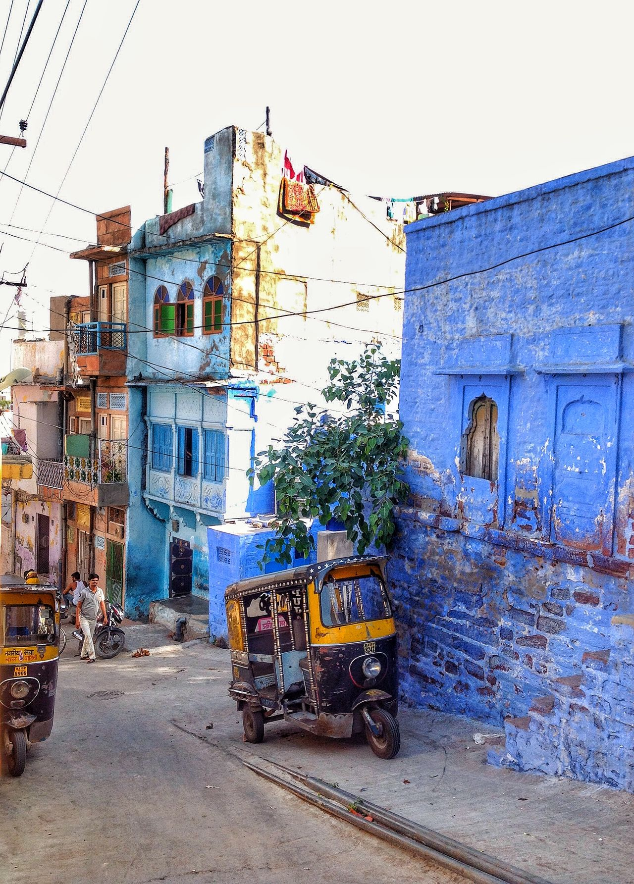 Architecture Building Building Exterior Built Structure Cable City City Life Day India Jodhpur Mode Of Transport Outdoors Parked Parking Power Line  Residential Building Residential Structure Sky Stationary The Street Photographer - 2016 EyeEm Awards Town Tuk Tuk The Blue City Jodhpur India Streets Of India