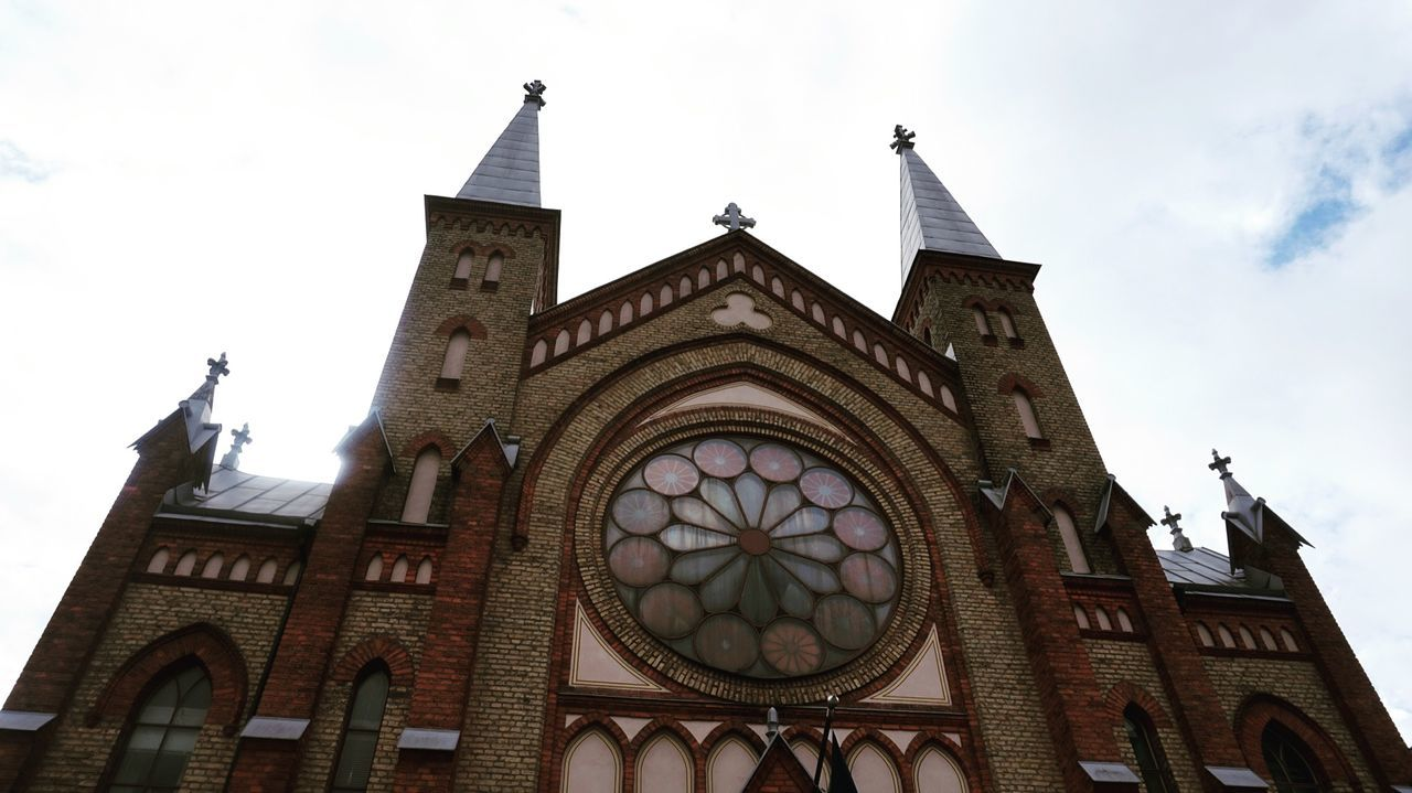 Architecture Building Exterior Built Structure Clock Day Low Angle View No People Outdoors Place Of Worship Religion Rose Window Sky Spirituality