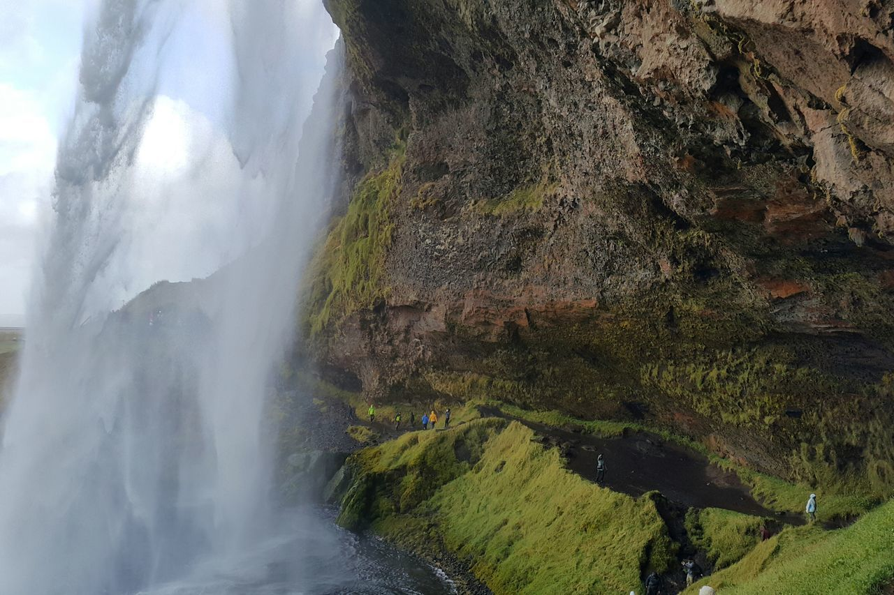 waterfall landscape moss river tourism tranquil scene Nature Flowing water mist power in nature tiny people majestic Iceland My Year My View miles away
