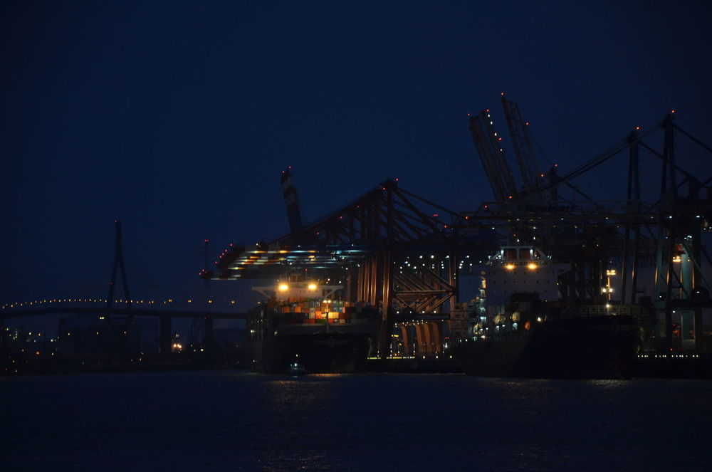 Still working, hello morning A7 Boxes Container Container Ship Container Terminal Freight Transportation Hamburg Harbor Illuminated Industry Nacht Night No People Outdoors Quay Cranes Shipping  Transportation Water Waterfront