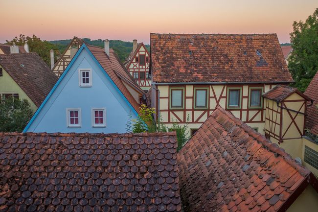 Architecture Building Exterior Built Structure City City Life Daybreak Half-timbered House House No People Orange Color Outdoors Residential District Rooftop Sky Southern Germany Stone Material