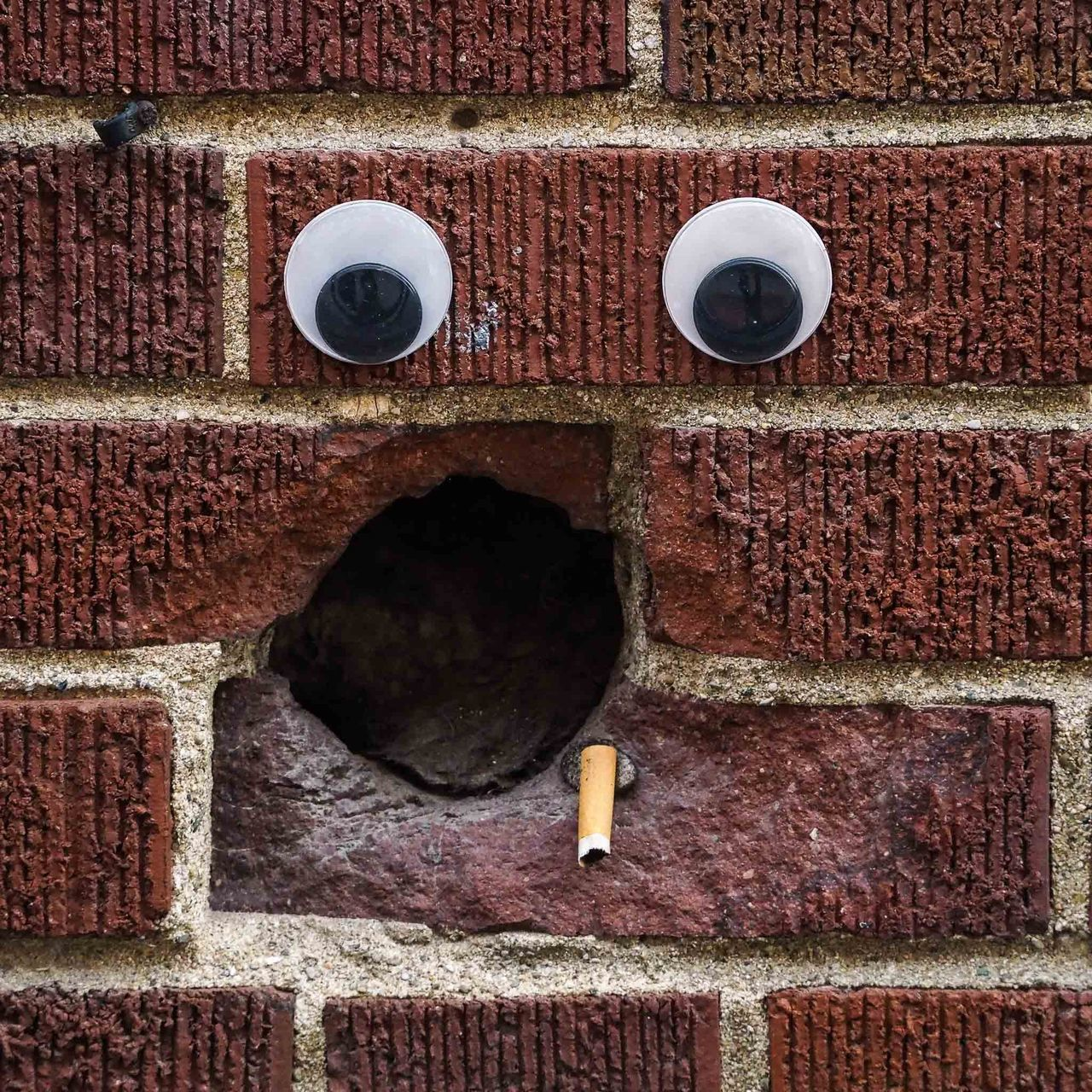 brick wall, architecture, day, outdoors, no people, built structure, textured, red, building exterior, close-up, anthropomorphic face