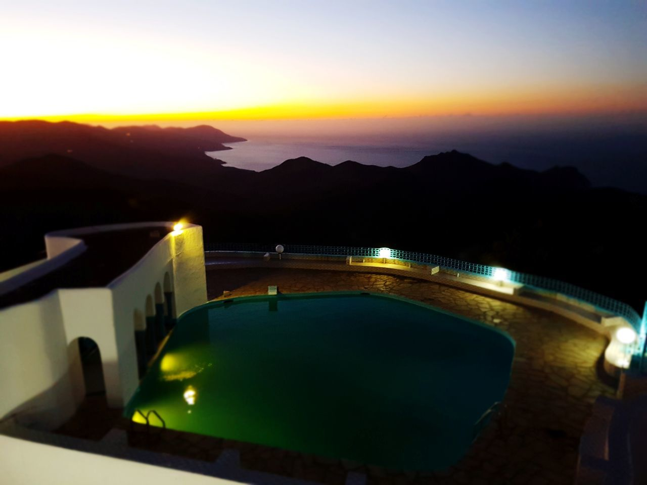 Night Water Sunset Mountain Luxury Tourist Resort Architecture Swimming Pool Travel Destinations Scenics Sky Nature No People Outdoors