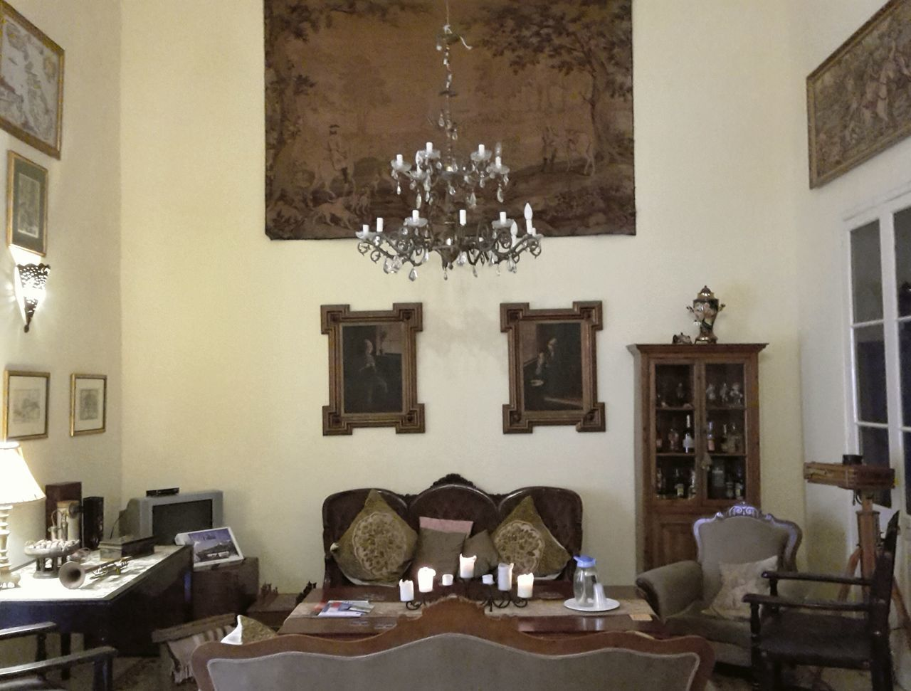 Livingroom of a historic house in Valletta, Malta Indoors  Architecture Home Showcase Interior No People Domestic Life Day Historic Old Medieval Architecture Medieval Luster Chandelier Painting Sofa Tapestry Large Ceiling Height Vitrine Past Past Times  House Interior Furniture