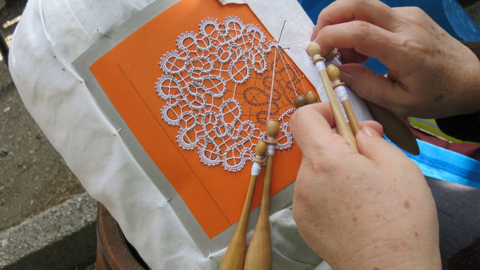 realization of lace with pillow Ancient Bobbin Embroidery Hand Jobs Handmade Lace Laces Pins Sewing Tombolo Traditional Culture Wires Wooden Work In Progress