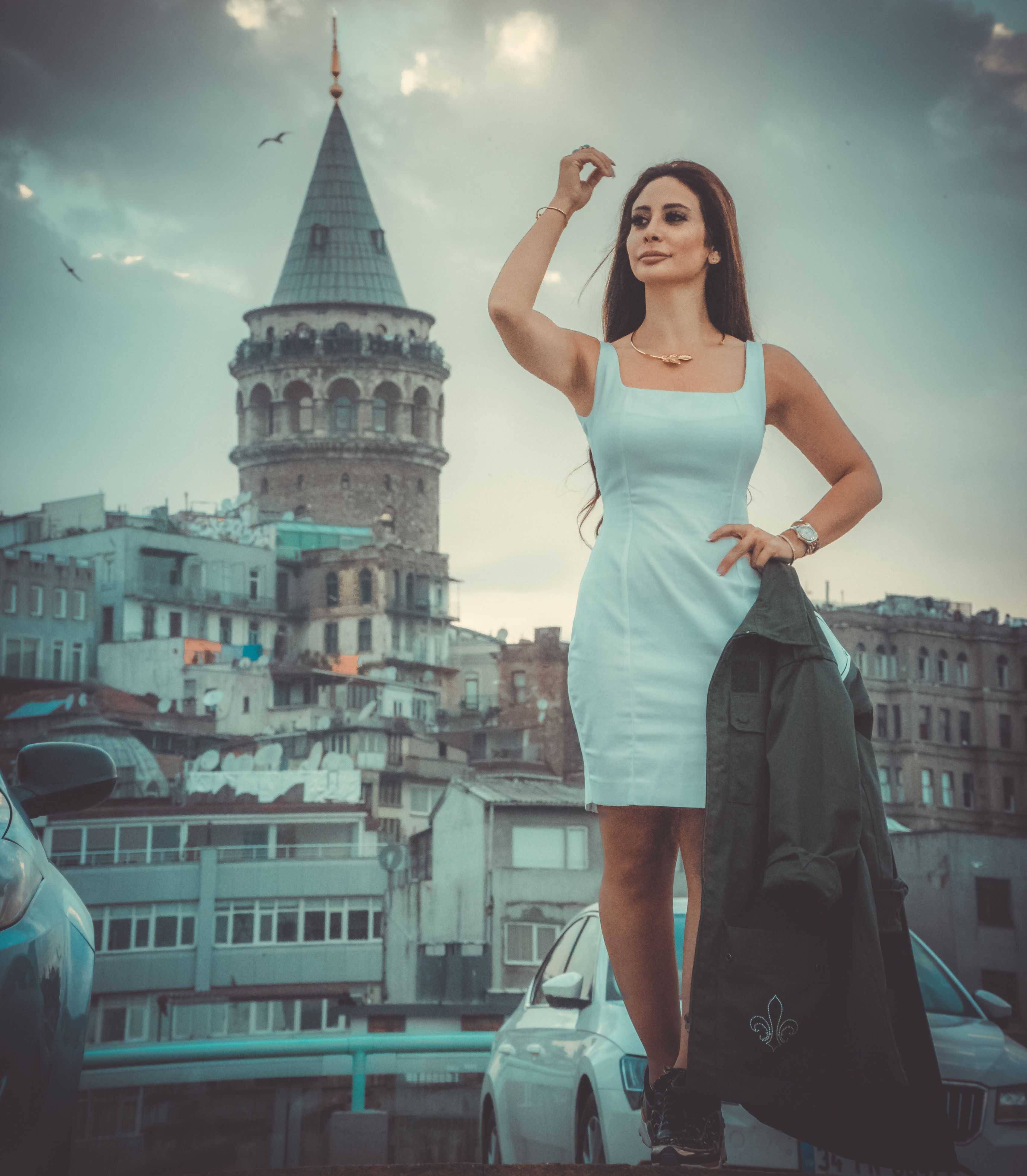 architecture, real people, building exterior, built structure, leisure activity, one person, lifestyles, outdoors, young adult, sky, young women, casual clothing, front view, beautiful woman, standing, day, travel destinations, city, full length