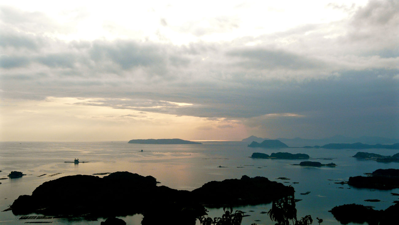Around The Kyushu SASEBO Stock Photo / 17:47 Ishidake Observing : before Sunset Silhouettes Kujukushima Islands - Ishidake, Sasebo City. Nagasaki JAPAN Japan Scenery Nagasaki September 11, 2010. 展開峰もいいけど、石岳からもイイゾ de Good afternoon Beauty In Nature Cloudy Sky Horizon Over Water Landscape Majestic Ocean View Sunset Silhouettes Walking Around The City  佐世保 石岳展望台 美しき天然