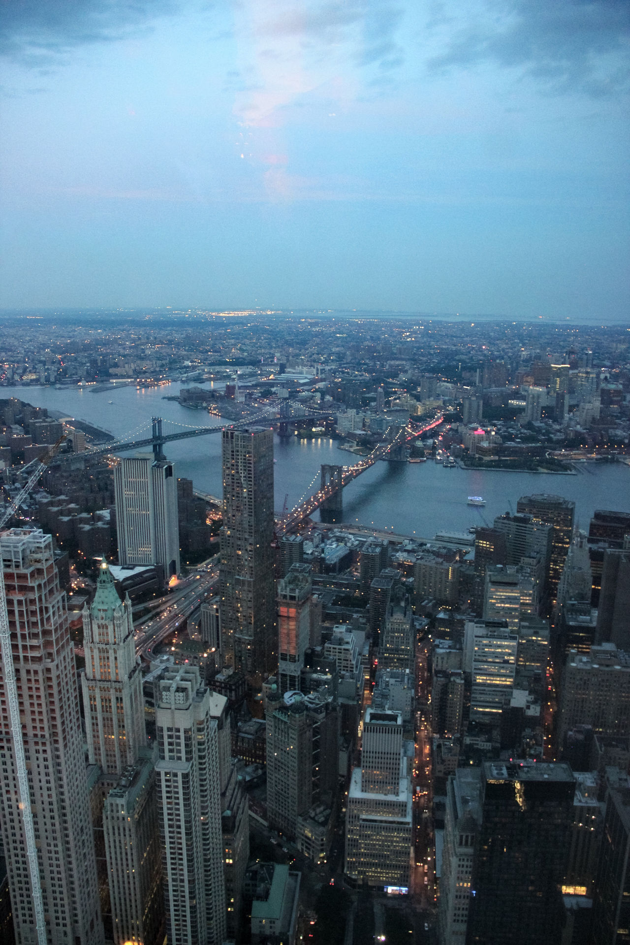 Aerial View Architecture Battle Of The Cities Blue Building Exterior Built Structure Capital Cities  City Cityscape Development Dusk Financial District  High Angle View No People Office Building River Sea Sky Skyscraper Tall Tall - High Tower Water Waterfront Wide Shot