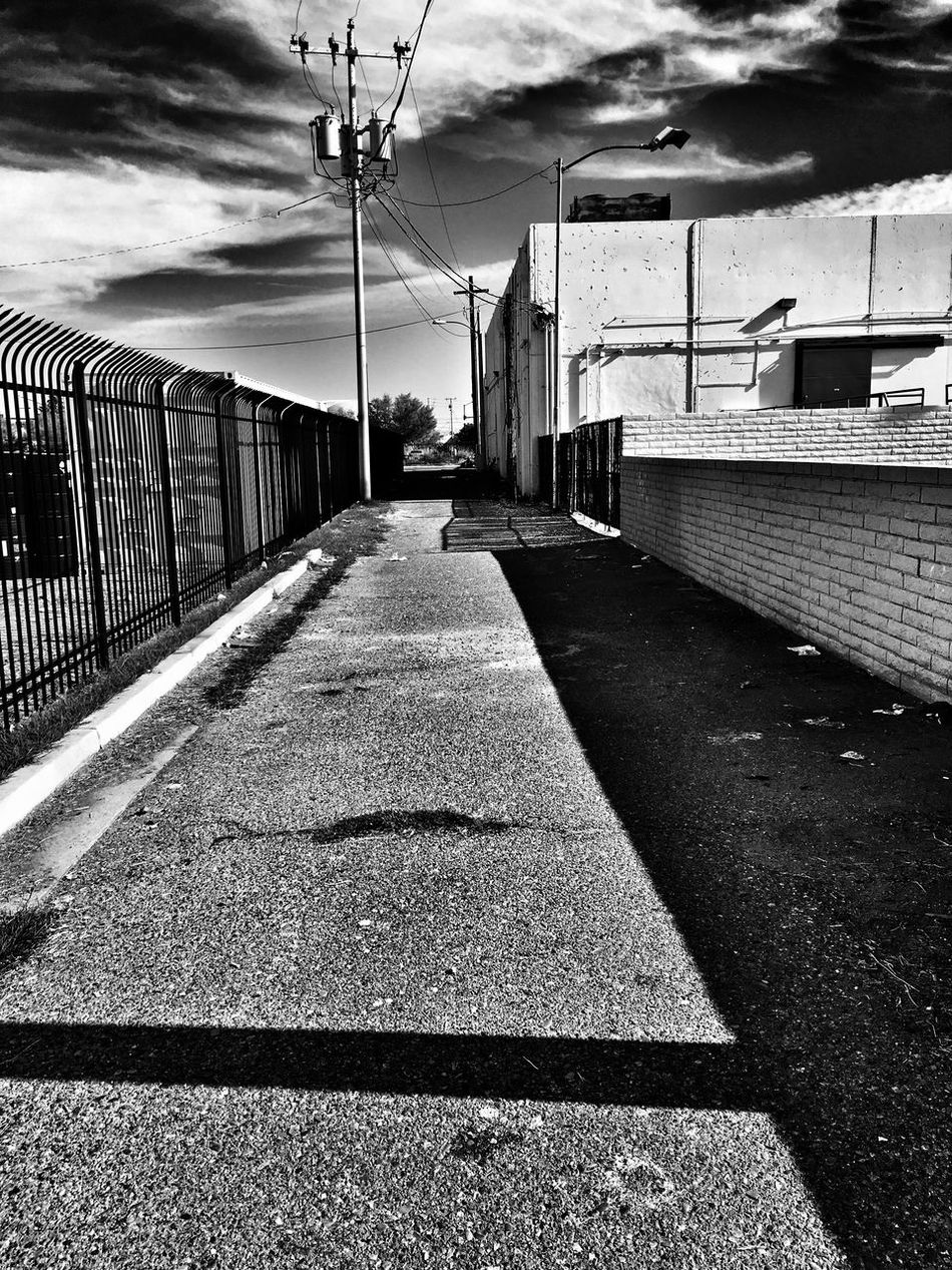 Alley The Way Forward Sky Cloud - Sky Day Outdoors Built Structure Architecture No People Road Connection Electricity Pylon Bridge - Man Made Structure Nature Black And White Photography Alleyezonmayphotography Alleyway Popular Photos Check This Out EyeEm Gallery Phoenix, AZ