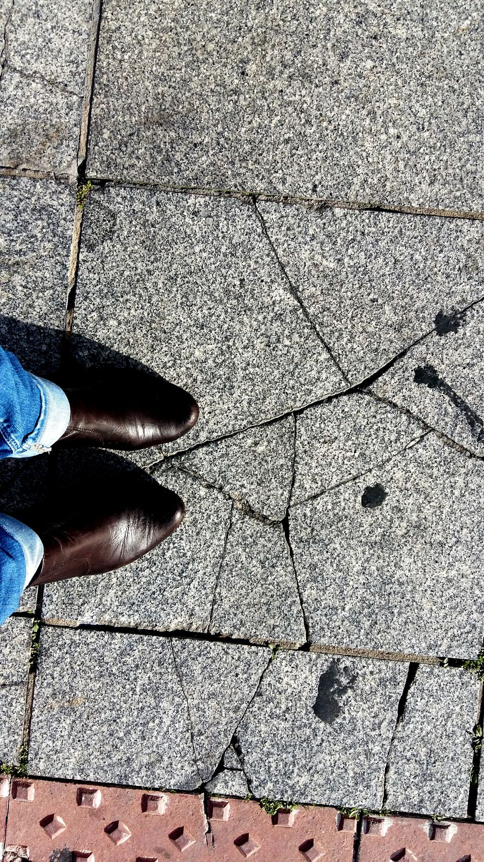 Walking Around The City  Walking On The Street Streetphotography Streetfashion Stree Photography Urban Photography Urban Scene Urban Fashion Tilesphotography Broken Tiles Boots And Jeans Womanfashion Blogger City