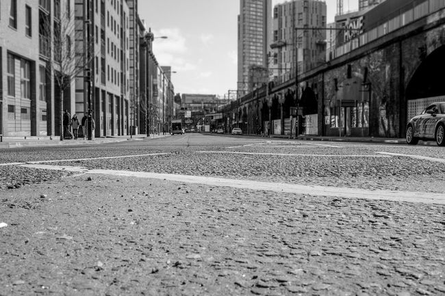 Architecture B&w Street Photography Building Work City Diminishing Perspective Incidental People Manchester Mouse Level Railway Viaduct Street Street Level Surface Level The Way Forward Vanishing Point Viaduct