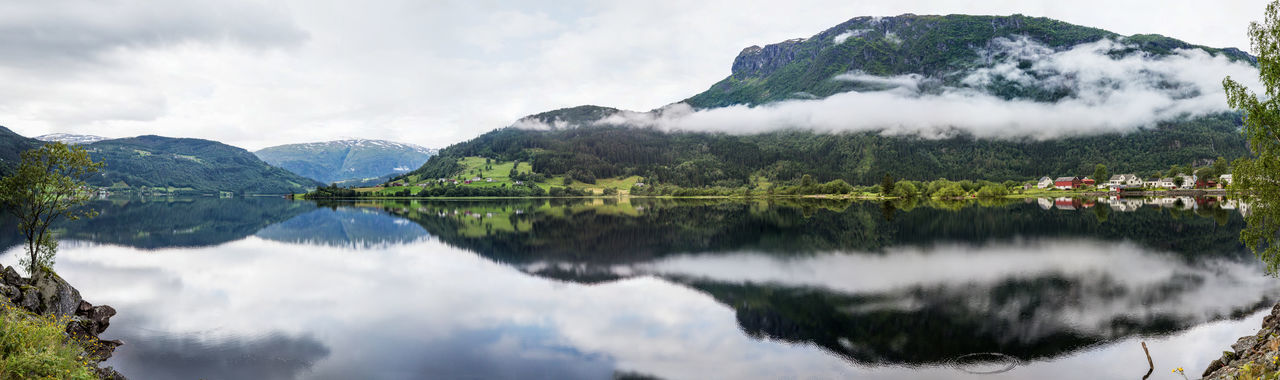 Panoramic View Of Mountain And Clouds Reflection In Lake