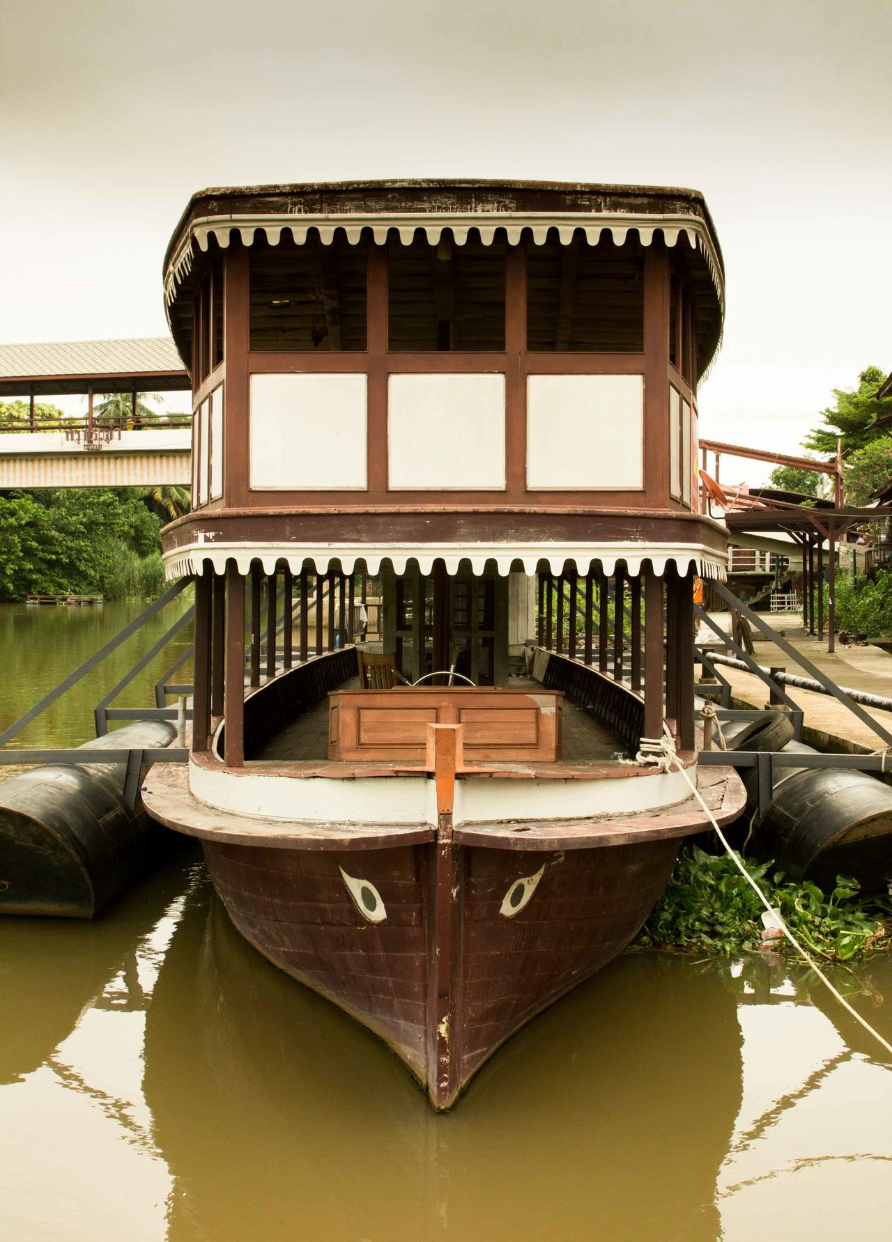 an old wooden boat is made to be a floating house in the river Architecture Boat Boat Ride Boat-house Built Structure Outdoors Thai Boat Thai Ferry Wooden Boat