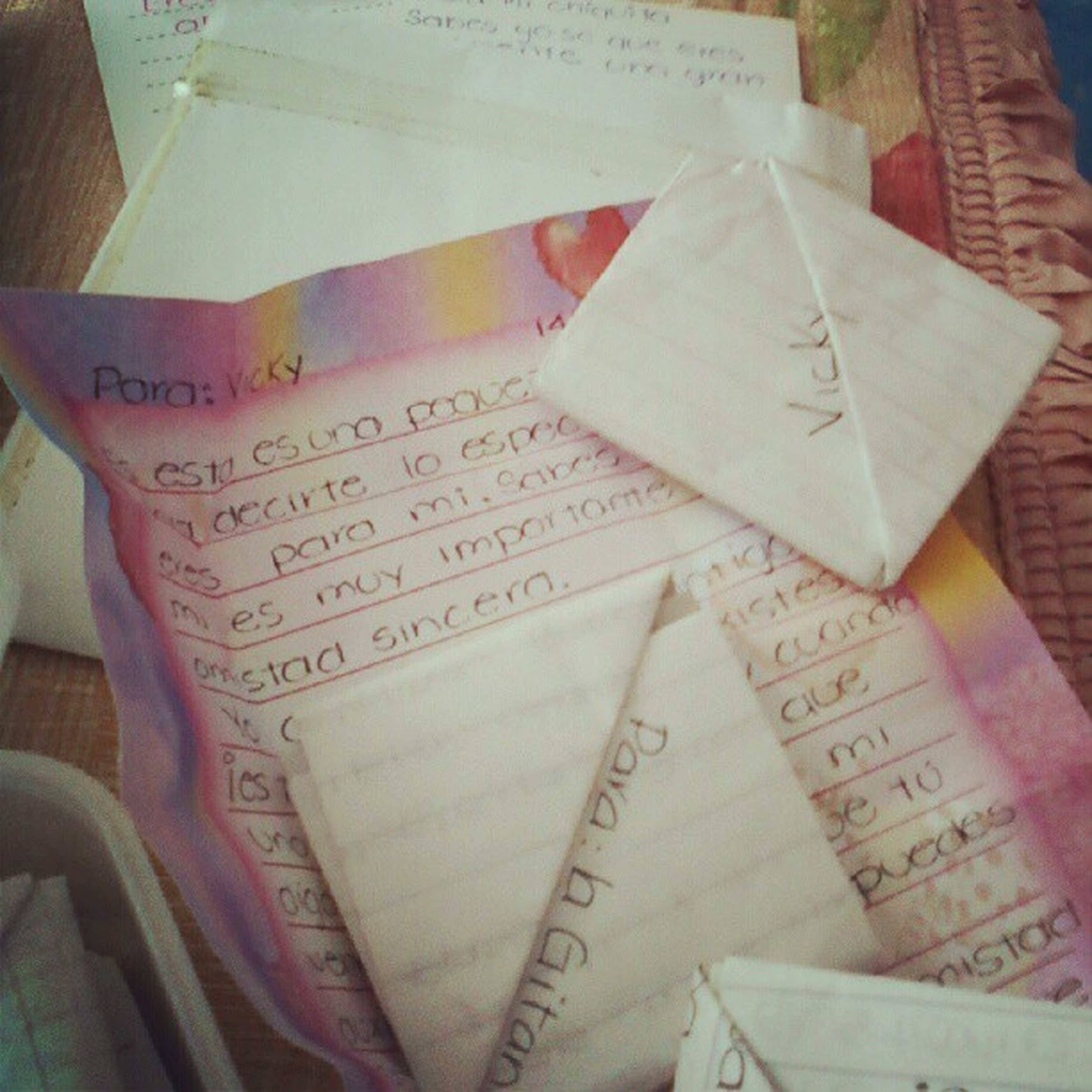 text, indoors, book, western script, paper, communication, education, high angle view, close-up, still life, non-western script, variation, table, large group of objects, handwriting, no people, choice, open, learning, message
