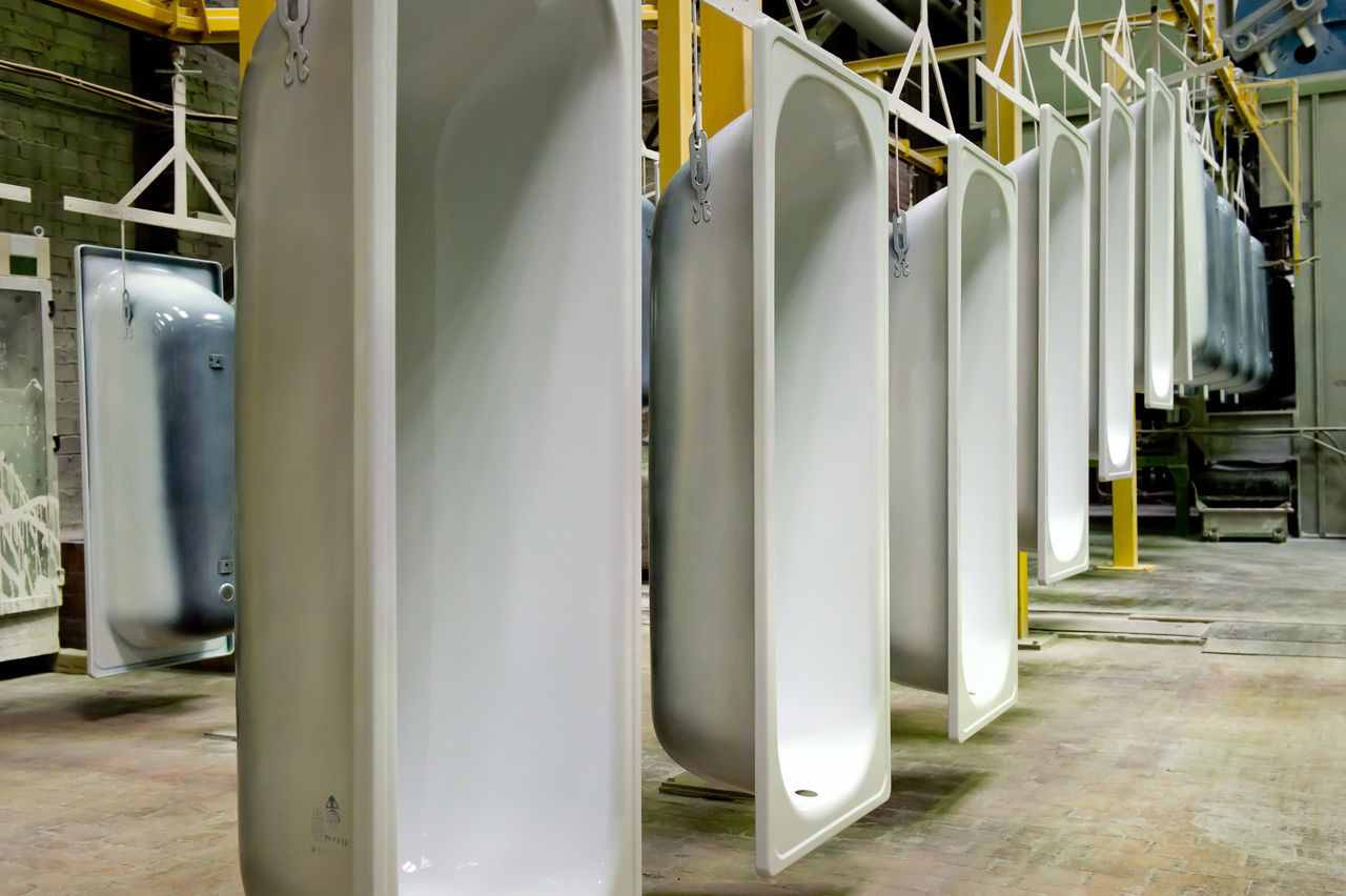 White Bathtubs Hanging On Production Line At Upper Iset Plant
