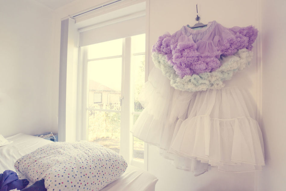 Romantic tulle skirt hanging in a bedroom Beauty Bedroom Clothes Curtain Daylight Door Dress Fashion Flooring Glass Glass - Material Home Interior Indoors  Lifestyles Living Purple Real People Room Sitting Skirt Transparent Tulle Wedding Window Women