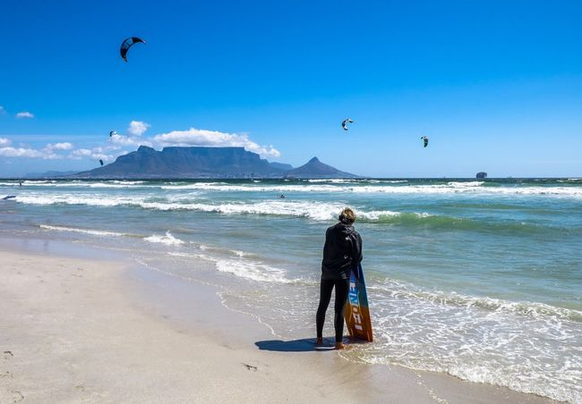 Extreme Sports In Awe Staring Wet Suit Kite Surfing Surfing Sea Beach Real People Wave Leisure Activity Full Length Shore Sand