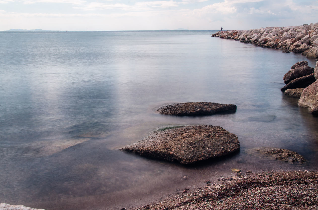 Calm-ness Beach Beauty In Nature Calm Calm Water Day Fisherman Nature No People Outdoors Rock - Object Scenics Sea Sky Tranquil Scene Tranquility Water