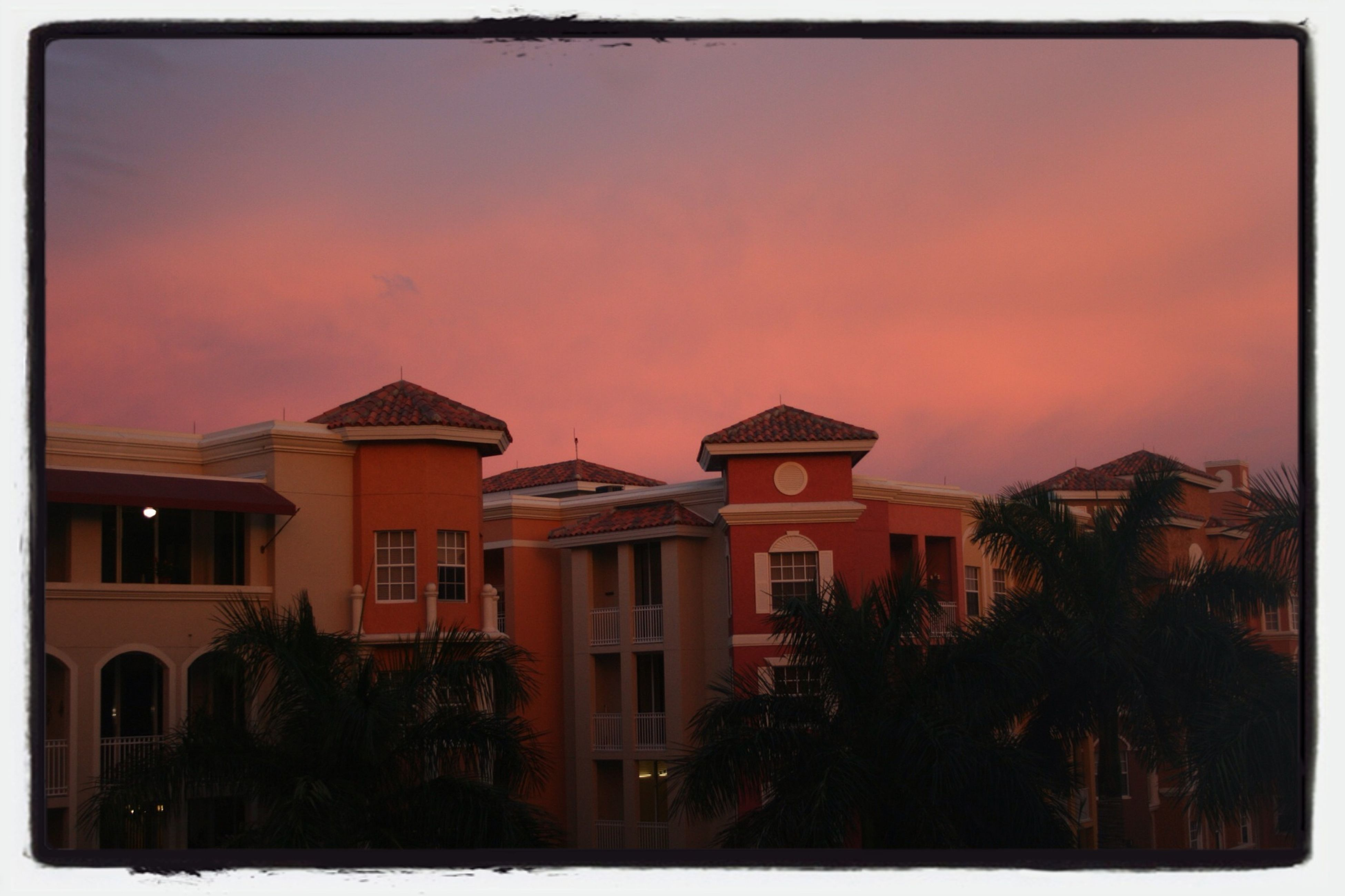 building exterior, architecture, built structure, transfer print, sunset, auto post production filter, sky, house, residential structure, residential building, orange color, city, building, tree, dusk, cloud - sky, outdoors, no people, residential district, low angle view
