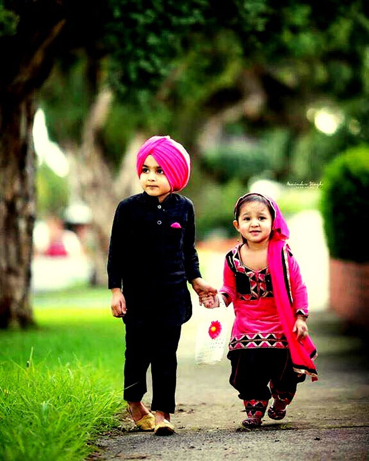 TakeoverContrast Togetherness Focus On Foreground Full Length Bonding Portrait Leisure Activity Love Childhood Front View Casual Clothing Park - Man Made Space Day Outdoors Cute The Culture Of The Holidays Human Face Fun Punjabi Kids Turban Grass Punjabisuit Kurta KurtaPajama