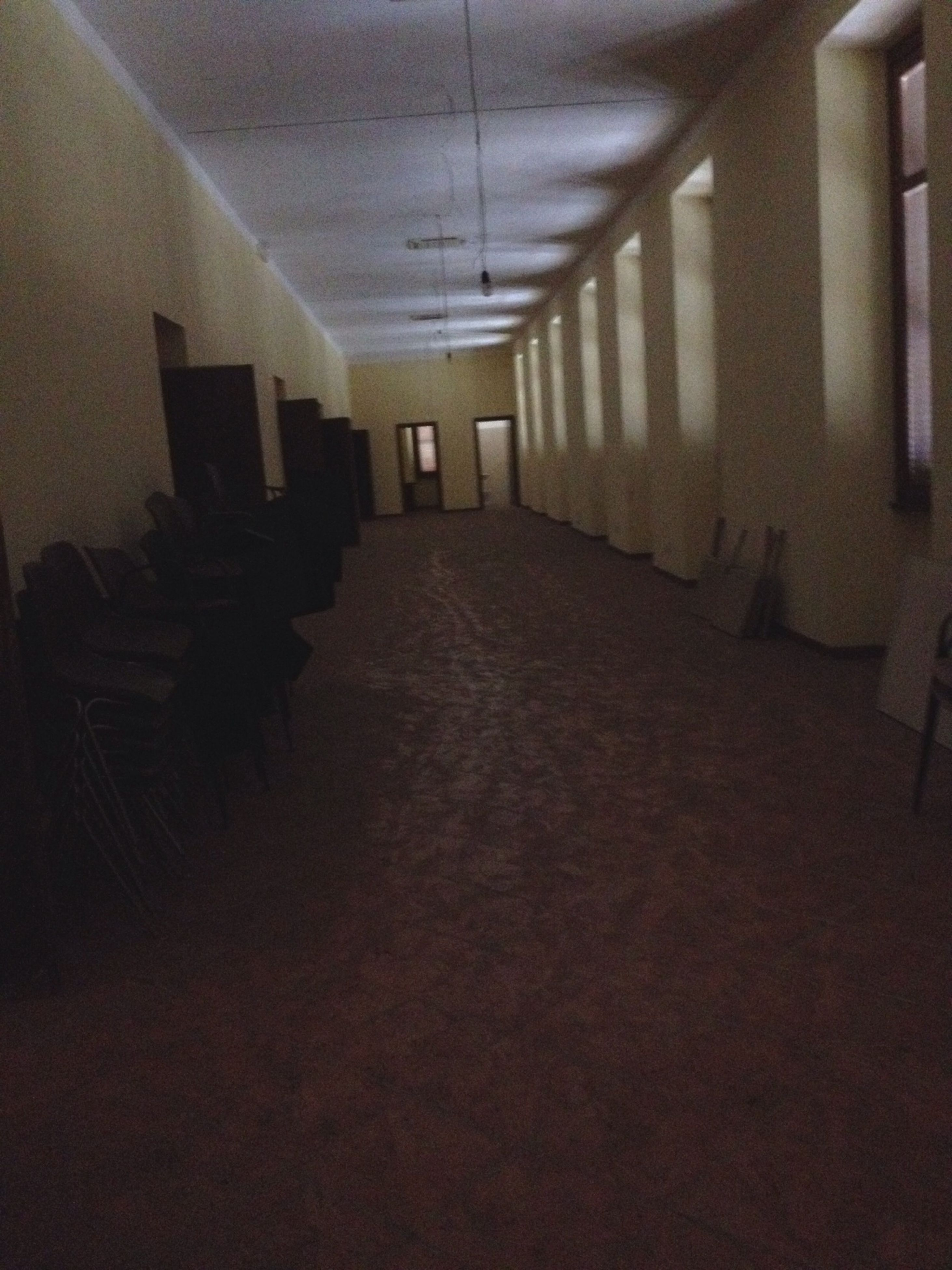 indoors, architecture, built structure, the way forward, diminishing perspective, empty, building, ceiling, corridor, narrow, lighting equipment, illuminated, wall - building feature, absence, building exterior, vanishing point, sunlight, no people, shadow, wall