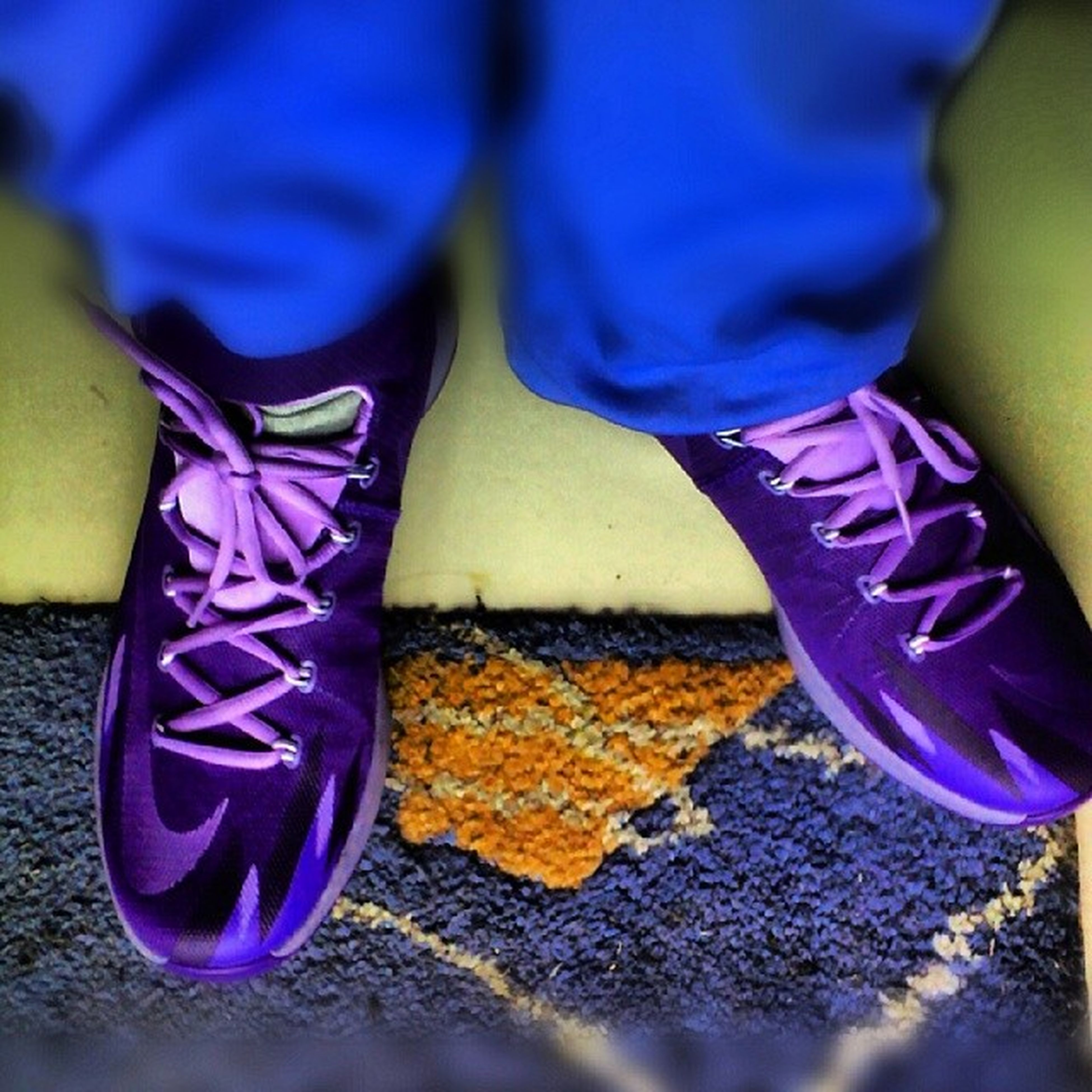 low section, person, blue, shoe, standing, lifestyles, casual clothing, leisure activity, multi colored, footwear, jeans, childhood, human foot, selective focus, high angle view, close-up, men, street