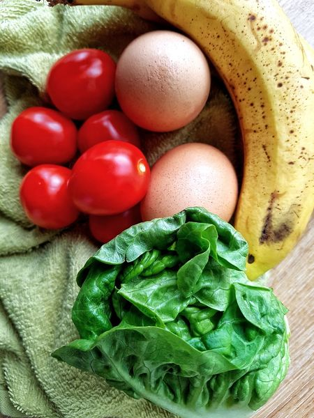 Egg Food And Drink Indoors  Food Freshness Green Color Healthy Eating Raw Food Close-up Kitchen Kitchen Utensils Flatlay Food Preparation Cooking Ingredients Tomatoes Red Colour Green Colour Fresh Vegetables Fresh Fruit Freshness Banana Yellow Food Flatlay Multi Colored Lettuce