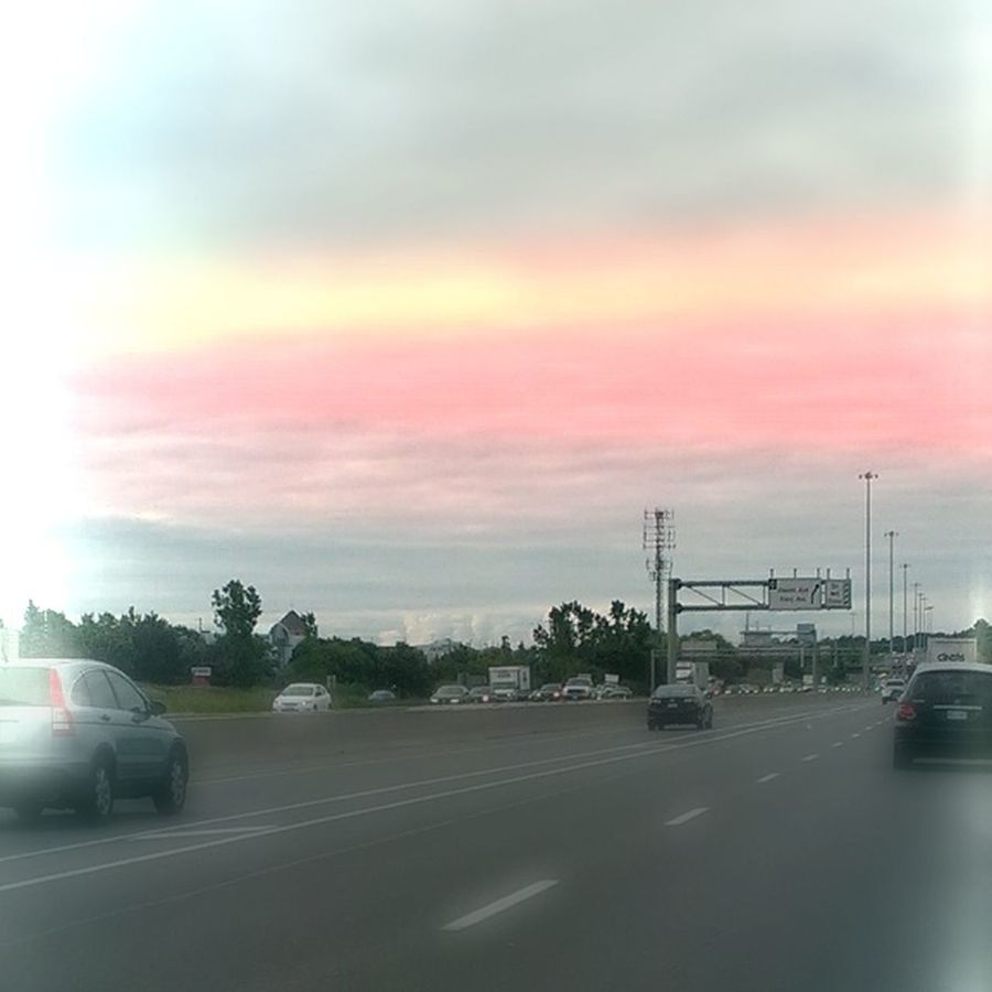 It is completely Photoshopped. It is not real sunset or sunrise. It was cloudy. Cloudy Day Not Sunset Photo Editing