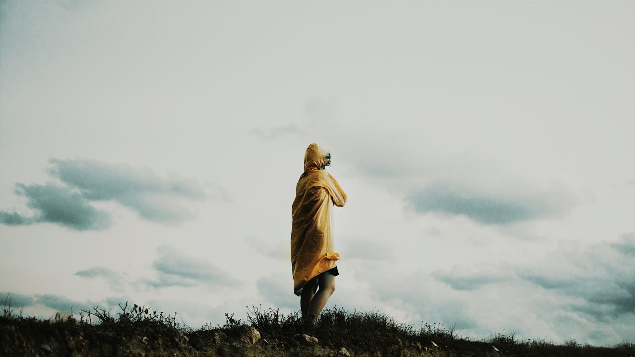 cloud - sky, sky, real people, walking, men, outdoors, nature, field, day, low angle view, one person, landscape, full length, mountain, mammal, people