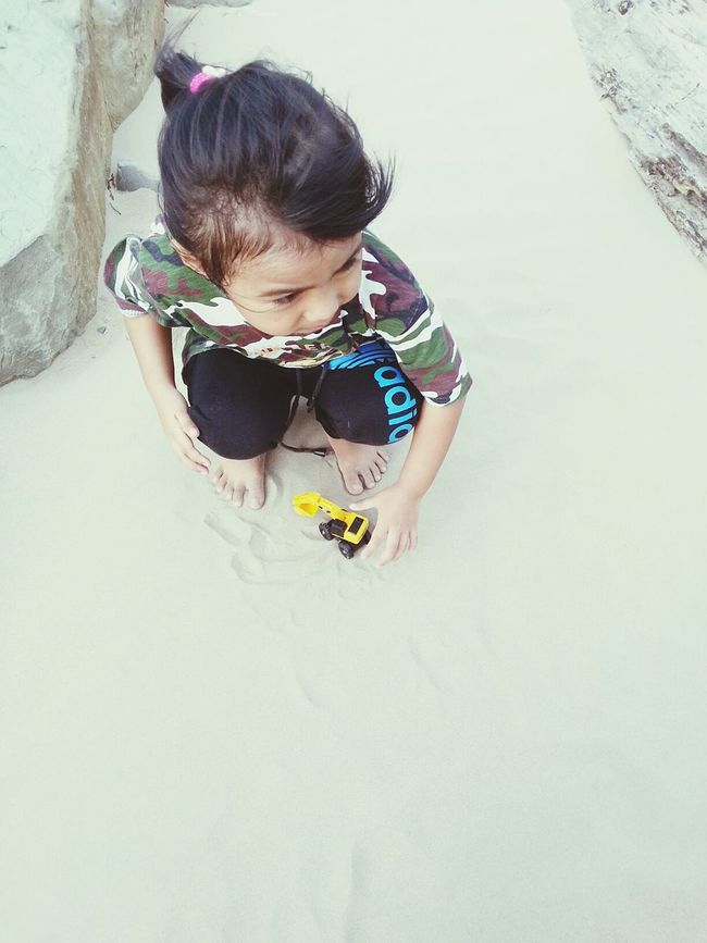 Childhood Elementary Age Lifestyles High Angle View Casual Clothing Looking Down Person Cute Toddler  Outdoors Baby Clothing New Life People And Places Leisure Activity Truck Toy Trucker Cats Kobelco Cat Sand Sandy Beach Beach Small Toy Yellow Kids Kids Being Kids