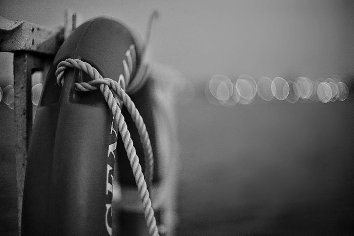 Details of a Lifebelt on a foggy day Bokeh Lights Black And White Elbe River Citylake Cityl Lake Foggy Day Alster River Port Of Hamburg  Harbour Lifebelt EyeEm Selects Rope Tied Up Close-up No People Tied Knot Outdoors Focus On Foreground Hanging Nautical Vessel Day