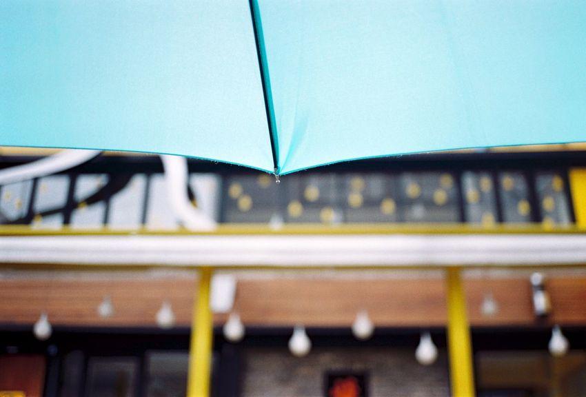 Focus On Foreground Umbrella Rain Rainy Days Rain Drops Street Photography Film Photography Contaxt2 35mm Film Filmcamera Filmisnotdead