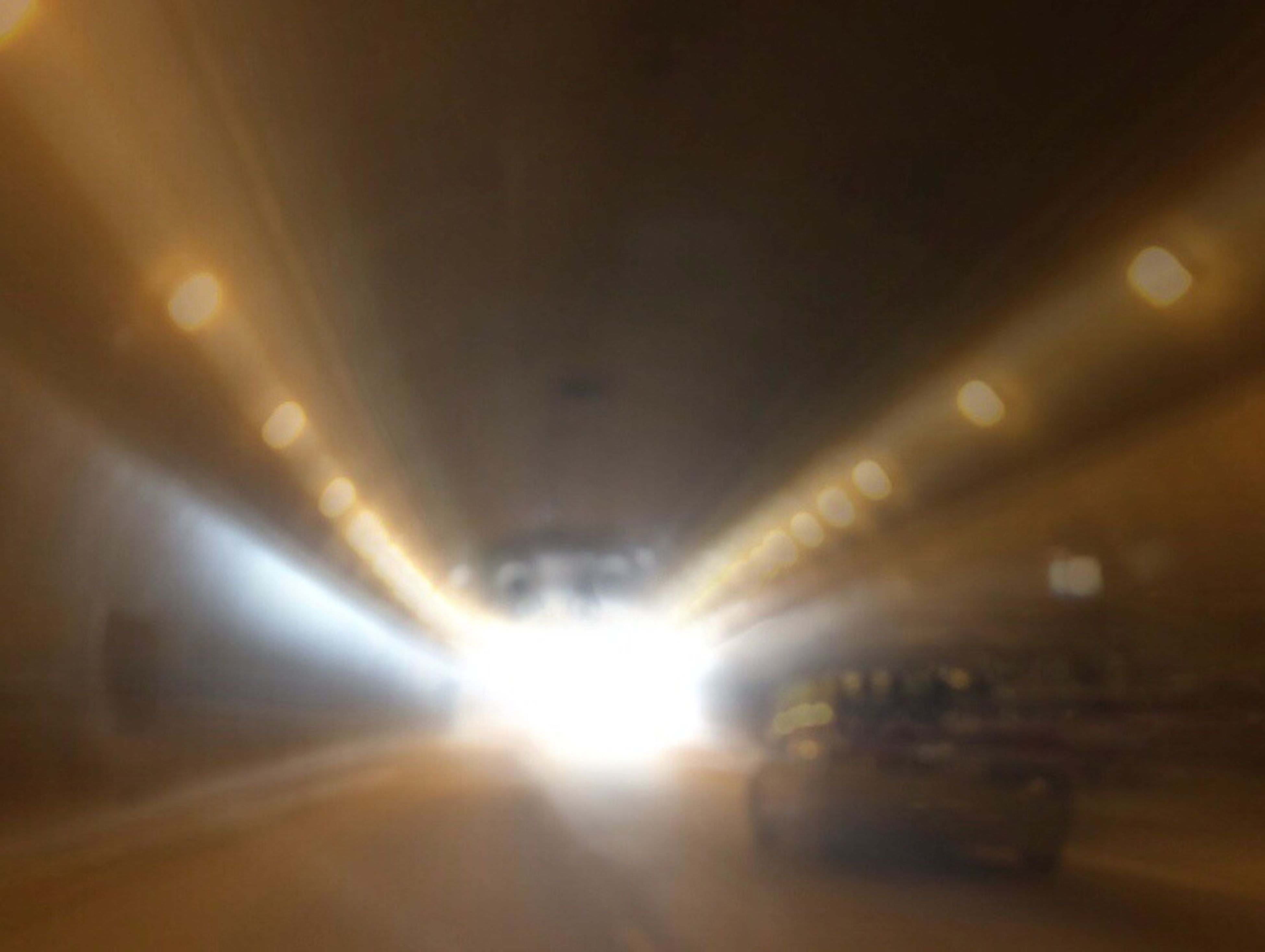 illuminated, transportation, the way forward, indoors, architecture, built structure, lighting equipment, diminishing perspective, night, tunnel, light - natural phenomenon, lens flare, vanishing point, mode of transport, ceiling, road, no people, glowing, electric light, incidental people
