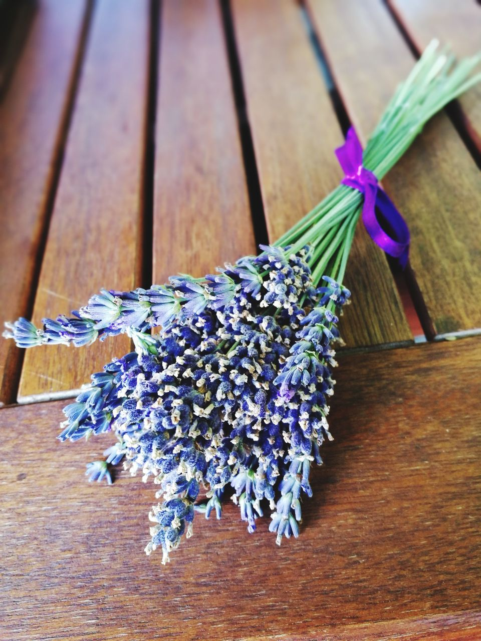 flower, freshness, purple, table, wood - material, fragility, lavender, close-up, no people, nature, petal, high angle view, indoors, tied up, flower head, scented, beauty in nature, hyacinth, day