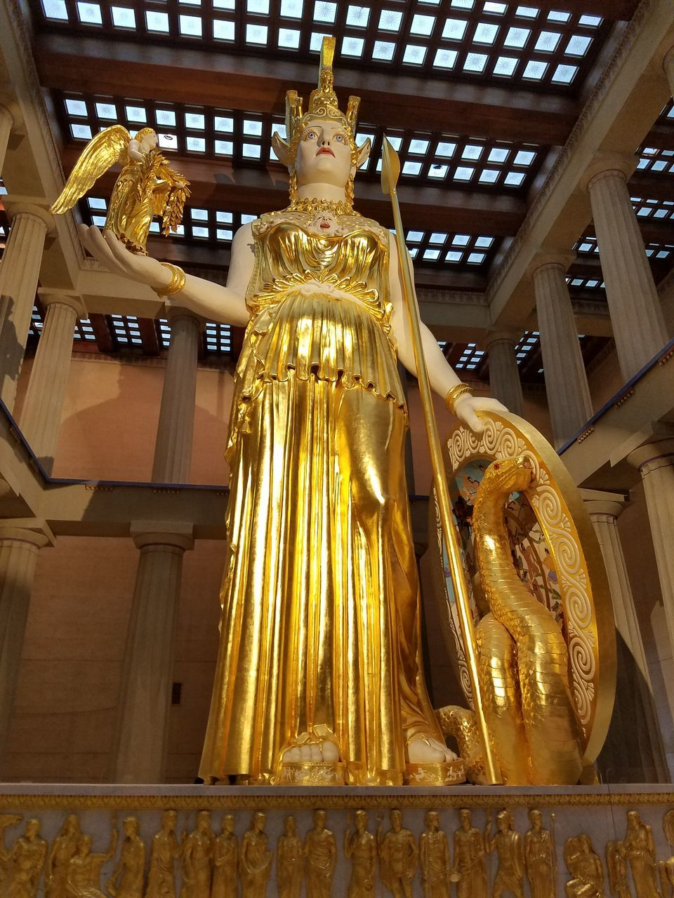 statue, gold colored, human representation, low angle view, sculpture, male likeness, architecture, travel destinations, gold, built structure, spirituality, history, indoors, travel, place of worship, no people, day, close-up