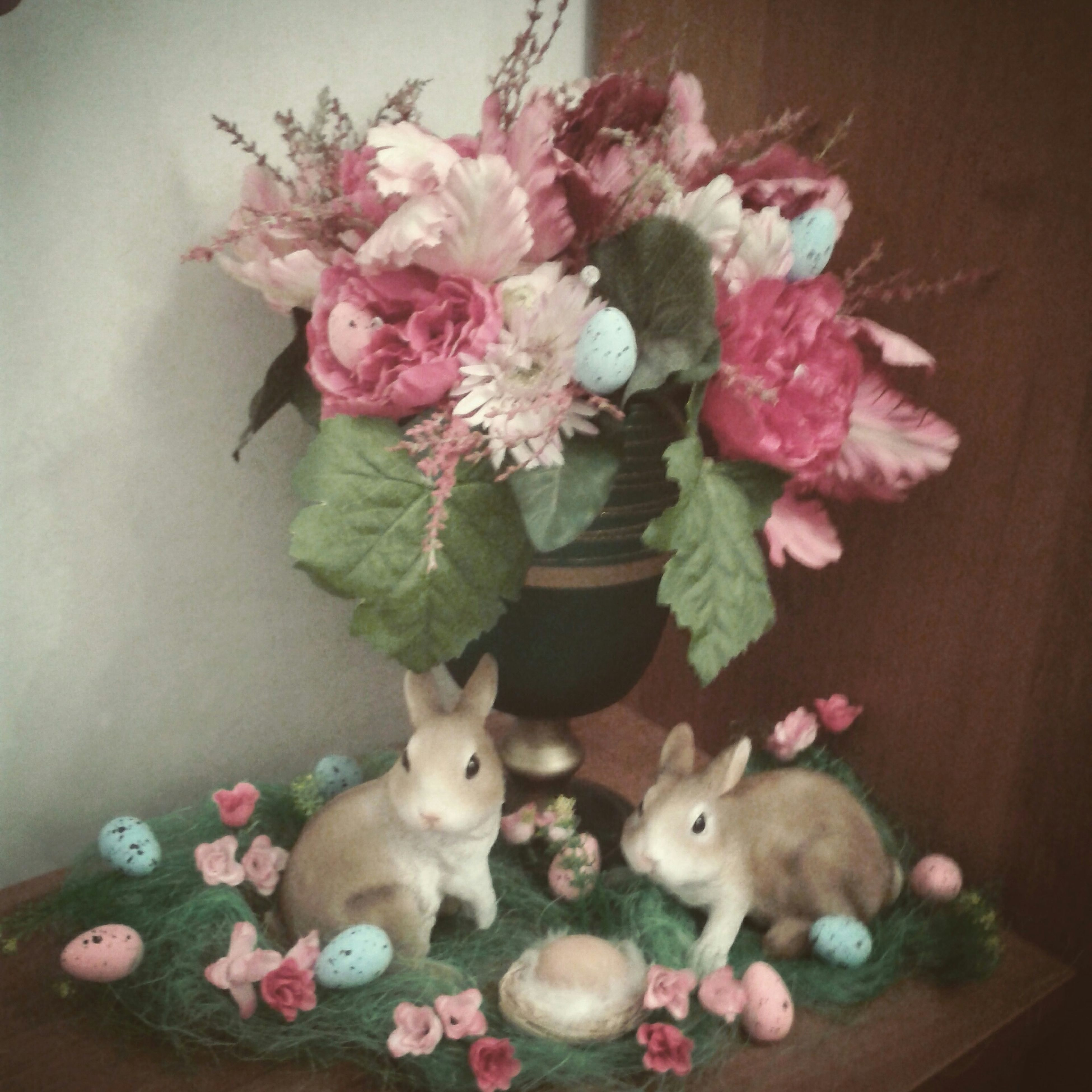 flower, indoors, vase, pink color, fragility, decoration, table, freshness, petal, home interior, animal representation, close-up, no people, still life, high angle view, nature, bunch of flowers, flower arrangement, animal themes, toy