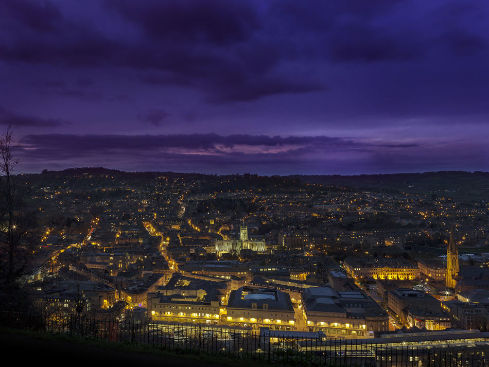 A vista of the city of Bath at night showing the lit-up streets and buildings, centrally located is the famous Bath Abbey. A Architecture Bath Blue Sky Building Exterior City Cityscape Cloud - Sky Downtown District Dusk Illuminated Landscspe Night No People Outdoors Purple Scenics Sky Sky And Clouds Skyporn Sunset Urban Landscape Urban Skyline