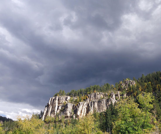 Storm clouds building over Spearfish Canyon in South Dakota Spearfish Canyon Weather Beauty In Nature Cliff Cloud - Sky Day Landscape Low Angle View Mountain Nature No People Outdoors Physical Geography Rock - Object Rock Formation Rock Hoodoo Scenics Sky Spearfish Canyon Storm Cloud Stormy Sky Tranquil Scene Tranquility Travel Destinations Tree