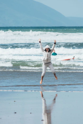 Beach Cheerful Day Fun Jumping Motion One Person Outdoors Sand Sea The Human Body Vacations Water