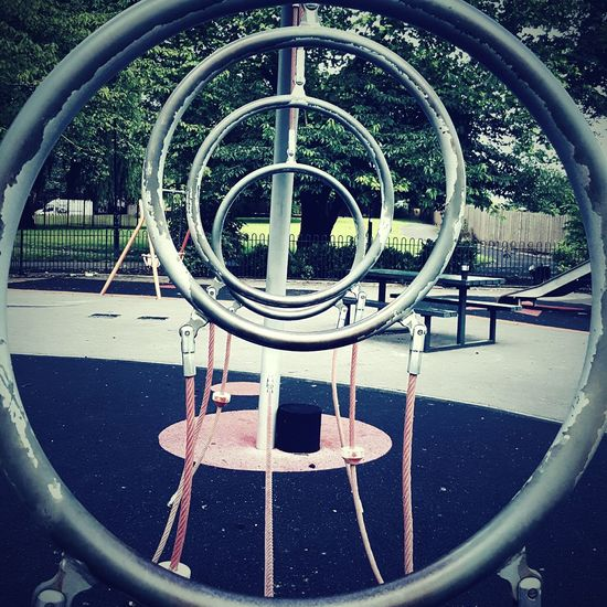 This Is Perspective day 3. Four Hoops Four Rings Same Size Looking Through Perspective In The Playground
