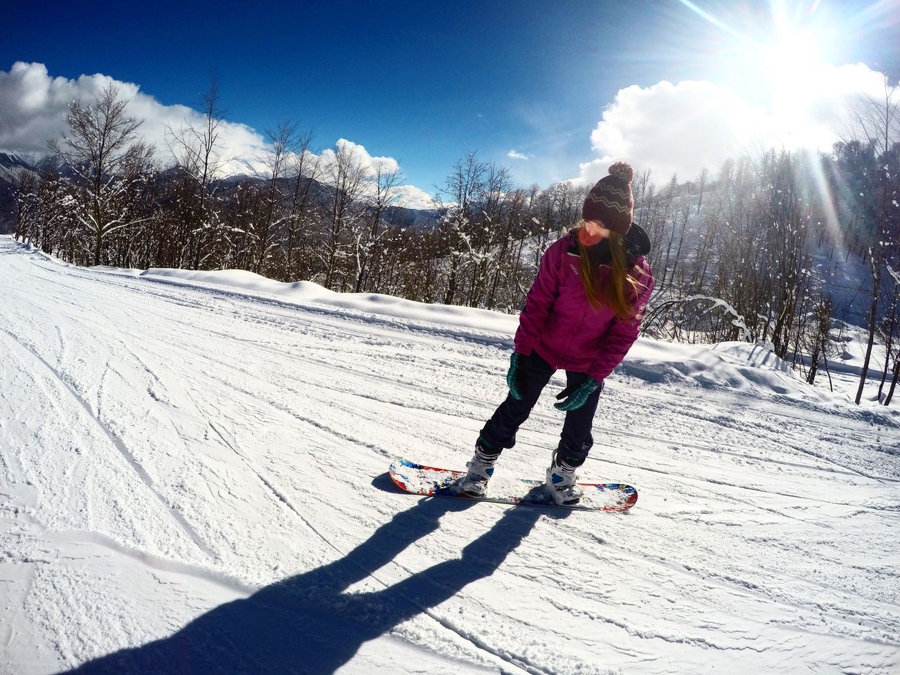 Snow Winter Cold Temperature Sunlight Warm Clothing Full Length Leisure Activity One Person Real People Outdoors Lifestyles Day Ski Holiday Sun Sky Childhood Tree Snowboarding Nature People Snowboard Sochi Rosakhutor