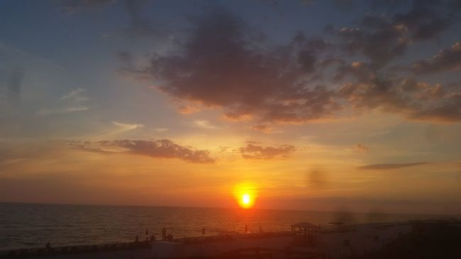 People And Places Sunset Sea Water Horizon Over Water Scenics Sun Tranquil Scene Orange Color Beauty In Nature Idyllic Tranquility Sky Nature Cloud - Sky Majestic Cloud Non-urban Scene Outdoors Moody Sky Calm